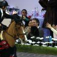 Marion Cotillard complice et tendre avec son fils Marcel devant Guillaume Canet au quatrième jour des Gucci Paris Masters 2014 à Villepinte le 7 décembre 2014