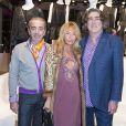 """Didier Ludot et son ami entoure Maryam Mahdavi - Présentation du sac """"Balloon Dog"""" de Jeff Koons pour H&M au centre Pompidou à Paris le 9 décembre 2014."""