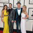Macklemore avec sa compagne Tricia Davis et Ryan Lewis lors des Grammy Awards lors des 56e Grammy Awards au Staples Center de Los Angeles, le 26 janvier 2014