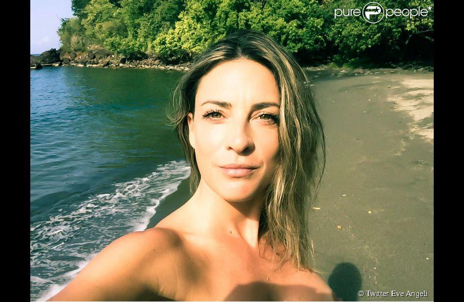 Eve Angeli topless à la Guadeloupe, le 6 février 2015.