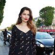 Laetitia Casta (habillée en Dior Haute Couture) - Arrivées à l'avant-première du film 'Sous les jupes des filles' à l'UGC Normandie sur les Champs Elysées à Paris le 2 juin 2014.