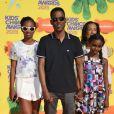 Chris Rock et ses filles Lola et Zahra assistent à la 28e édition des Kids Choice Awards, au Forum. Inglewood, Los Angeles, le 28 mars 2015.