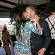 Kris Smith et Maddy King assistent à la Melbourne Cup Race Day à Melbourne, en Australie, le 5 novembre 2013