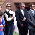 """La princesse Charlène de Monaco porte son chien """"Monté"""" (comme Monte Carlo) en compagnie de son frère Gareth lors de la 5e édition du """"Tournoi Sainte-Dévote"""" organisé par la Fondation Princesse Charlène de Monaco et la Fédération Monégasque de Rugby au Stade Louis II à Monaco, le samedi 11 avril 2015."""