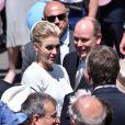 Albert II de Monaco et son épouse Charlene à la rencontre des Monégasques en remontant la rue Bellando de Castro vers la place du Palais - Baptême de Jacques et Gabriella en la cathédrale Notre-Dame-Immaculée de Monaco le 10 mai 2015