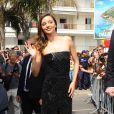 Miranda Kerr, glamour et pétillante, arrive à la plage Magnum à Cannes le 14 mai 2015.
