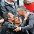 Jean-Luc Reichmann, sa femme Nathalie et Philippe Bas - People dans les tribunes des Internationaux de France de tennis de Roland Garros à Paris. Le 31 mai 2015.