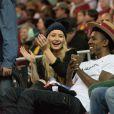 Iggy Azaela et son petit-ami Nick Young assistent au mach de basket des UCLA Men à Los Angeles, le 14 janvier 2015.