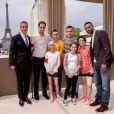 """Exclusif - Grand Corps Malade et Tony Parker avec les enfants de l'association """"Sourire à la Vie"""" lors du Paris Eiffel Jumping du Longines Global Champions Tour, le 5 juillet 2015 sur le Champs-de-Mars à Paris"""