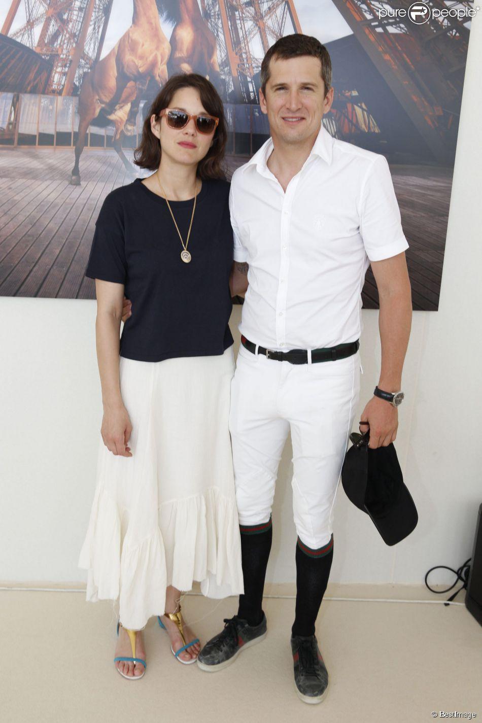 Exclusif - Marion Cotillard et son compagnon Guillaume Canet - People lors du Longines Paris Eiffel Jumping au Champ-de-Mars à Paris, le 4 juillet 2015.
