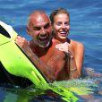 Exclusif - Christian Audigier et Nathalie Sorensen passent leurs vacances à Ibiza. Le 7 juillet 2013