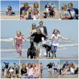 Willem-Alexander et Maxima des Pays-Bas, leurs filles et leurs labradors vous souhaitent de bonnes vacances d'été 2015 (séance photo du 10 juillet 2015 à Wassenaar)
