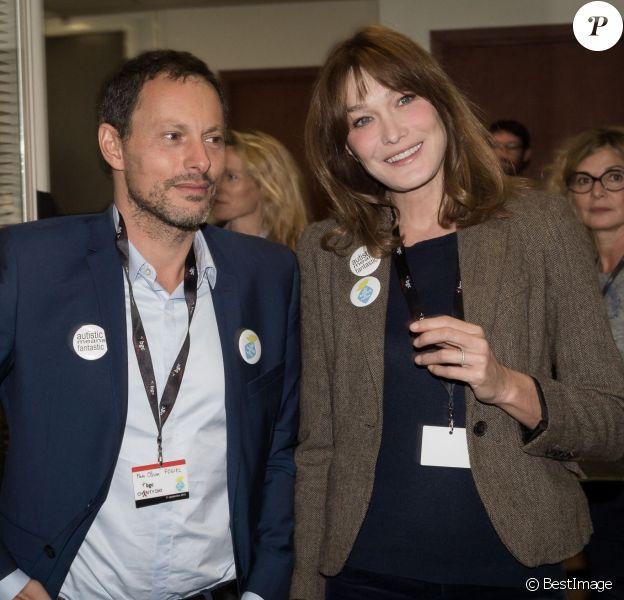 """Marc-Olivier Fogiel et Carla Bruni Sarkozy - 11e édition du """"BGC Charity Day"""" à Paris le 11 septembre 2015 en mémoire aux 658 collaborateurs du groupe BGC Partners (leader mondial du courtage interbancaire) disparus dans les attentats du World Trade Center, le 11 septembre 2001."""