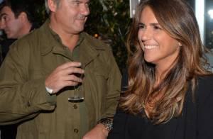 Valérie Benaïm tout sourire avec Patoche lors d'une soirée piscine très glamour