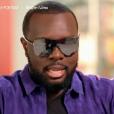 Le rappeur Maître Gims explique pourquoi il porte toujours ses lunettes de  soleil. Emission