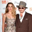 "Johnny Depp et sa compagne Amber Heard (robe Elie Saab) - Première du film ""The Danish Girl"" au festival International du film de Toronto (TIFF) le 12 septembre 2015"