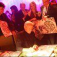 Peter Beard à la soirée Pirelli dédicace son calendrier