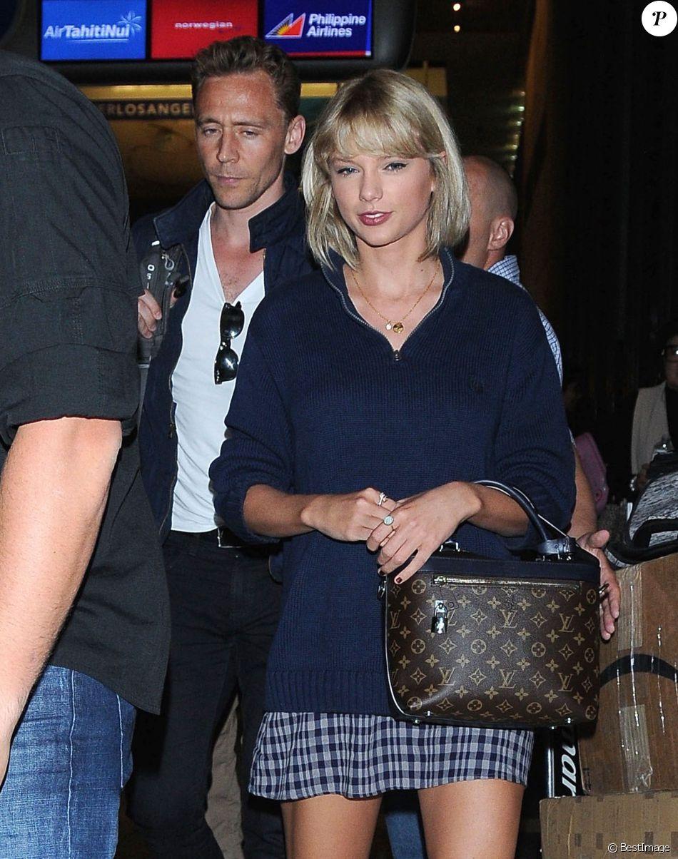 Taylor Swift et son compagnon Tom Hiddleston arrive à l'aéroport de LAX à Los Angeles, le 6 juillet 2016