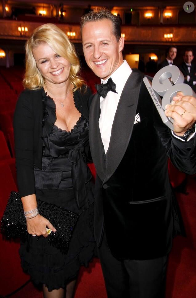 Michael Schumacher et sa femme Corinna lors de la soirée GQ à Berlin en Allemagne le 29 octobre 2010