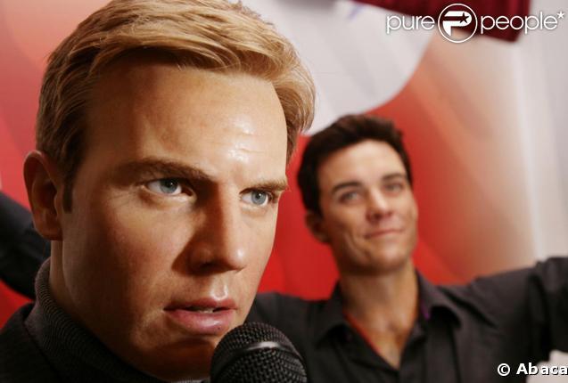 Les statues de cire de Gary Barlow et de Robbie Williams au musée Madame Tussauds