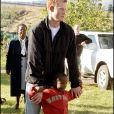 """Le prince Harry lors de sa visite au Lesotho en avril 2006. A cette époque, le prince s'était rendu en Afrique pour le lancement de sa nouvelle association, Sentebale (qui signifie """"ne m'oublie pas"""") en hommage à sa mère, la princesse Diana, disparue en 1997."""