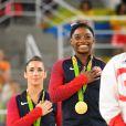 """""""Aly Raisman, Simone Biles et Amy Tinkler (Grande-Bretagne) aux Jeux olympiques de Rio. Août 2016."""""""