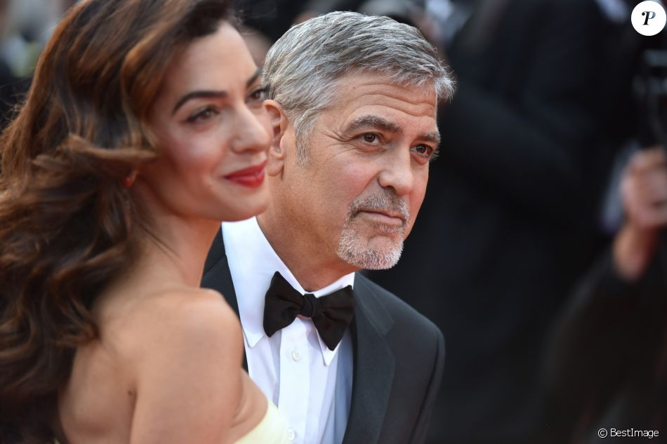 "George Clooney et sa femme Amal Clooney (bijoux Cartier) - Montée des marches du film ""Money Monster"" lors du 69ème Festival International du Film de Cannes. Le 12 mai 2016."