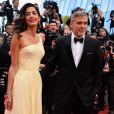 George Clooney et son épouse Amal Clooney sur le tapis rouge du Festival de Cannes le 12 mai 2016
