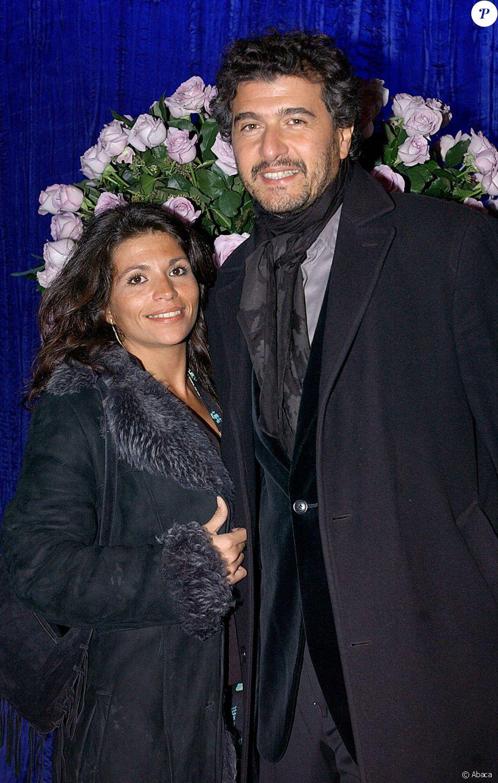 Daniel Lévi pose avec sa femme Laure au Lido le 21 octobre 2013.