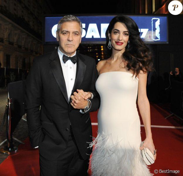 Exclusif - George Clooney et sa femme Amal Alamuddin-Clooney (enceinte) - 42ème cérémonie des César à la Salle Pleyel à Paris, le 24 février 2017.