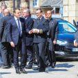 Le président élu Emmanuel Macron, Jean-Yves Le Drian, Richard Ferrand et Jean-Paul l'égliseéglise Saint-Jean-du-Baly à Lannion, le 10 mai 2017. Corinne Erhel est décédée le 5 mai lors d'un meeting du mouvement En Marche!.