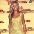 Beyoncé dans une robe transparente jaune, lors des MTV Movie Awards à L.A en 2001, n'a pas la classe qu'on lui connaît aujourd'hui.