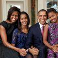 Michelle, Barack Obama et leurs filles Malia et Sasha à Washington. Décembre 2011.