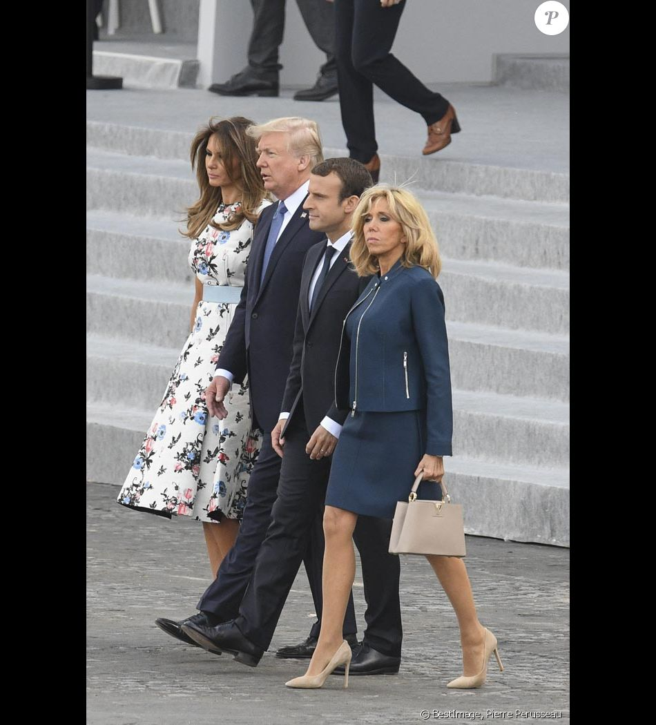Emmanuel Macron, sa femme Brigitte Macron (Trogneux) , Donald Trump et sa femme Melanie Trump lors du défilé du 14 juillet (fête nationale) à Paris