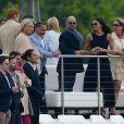 Meghan Markle assiste a un match de polo où joue son compagnon le prince Harry à Ascot le 6 mai 2017.