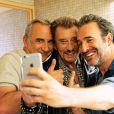 """Antoine Duléry, Johnny Hallyday et Jean Dujardin dans """"Chacun sa vie"""" de Claude Lelouch, en 2017."""