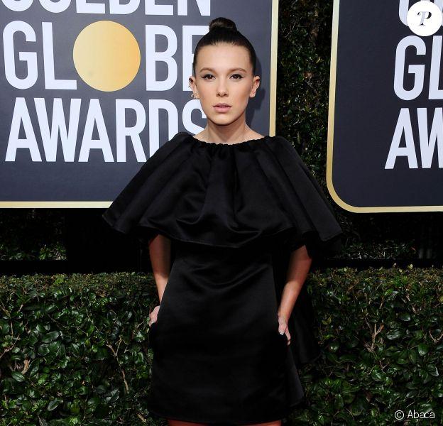Millie Bobby Brown, habillée d'une robe en satin CALVIN KLEIN BY APPOINTMENT accessoirisée de bijoux Repossi - 75e cérémonie des Golden Globes à l'hôtel Beverly Hilton. Beverly Hills, le 7 janvier 2018.