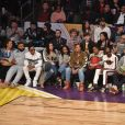 DJ Khaled et sa fiancée Nicole Tuck, Ludacris et son épouse Eudoxie Bridges, Queen Latifah, Snoop Dogg et son épouse Shante Braodus et Chance The Rapper assistent au NBA All-Star Game 2018 au Staples Center. Los Angeles, le 18 février 2018.