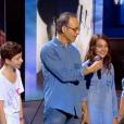 Jeff Panacloc et Jean-Jacques Goldman, lors du concert des Enfoirés à l'AccorHotels Arena à Paris, diffusé le vendredi 11 mars sur TF1.