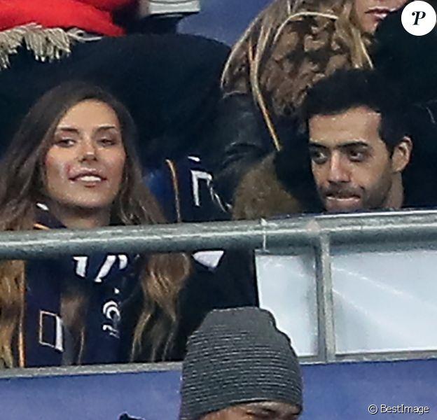 Exclusif - Camille Cerf et Tarek Boudali dans les tribunes du Stade de France lors du match de football amical France - Colombie à Saint-Denis le 23 mars 2018.