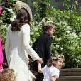 La duchesse Catherine de Cambridge au mariage du prince Harry et de Meghan Markle le 19 mai 2018 à Windsor. Elle portait pour l'occasion une nouvelle bague à la main droite.