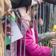 Meghan Markle portait de discrètes boucles d'oreilles Zofia Day le 18 janvier 2018 lors de sa visite à Cardiff avec le prince Harry.