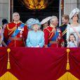 """La princesse Anne, la princesse Eugenie d'York, le prince Andrew, duc d'York,la reine Elisabeth II d'Angleterre, Meghan Markle, duchesse de Sussex, le prince Harry, duc de Sussex, duc de Sussex, le prince Charles, Kate Catherine Middleton, duchesse de Cambridge, le prince William, duc de Cambridge, la princesse Charlotte, Savannah Phillips, le prince George - Les membres de la famille royale britannique lors du rassemblement militaire """"Trooping the Colour"""" (le """"salut aux couleurs""""), célébrant l'anniversaire officiel du souverain britannique. Cette parade a lieu à Horse Guards Parade, chaque année au cours du deuxième samedi du mois de juin. Londres, le 9 juin 2018."""