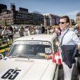 Le prince Joachim de Danemark devant sa voiture du Team Cortina Racing lors de la réception pour le Grand Prix Historique de Copenhague sur le parvis de l'Hôtel de Ville de la capitale danoise le 3 août 2018.