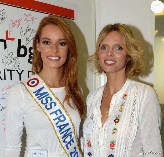 Maëva Coucke (Miss France 2018) et Sylvie Tellier (directrice générale de la Société Miss France et Miss France 2002) lors de la 14e édition du Charity Day dans la salle des marchés de la société de courtage Aurel BGC au profit des 7 associations participantes à Paris, le 11 septembre 2018. © Veeren/Bestimage