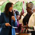 La duchesse Meghan de Sussex le 20 septembre 2018 au palais de Kensington pour le lancement du livre de recettes de cuisine Together, our community cookbook qu'elle a préfacé.