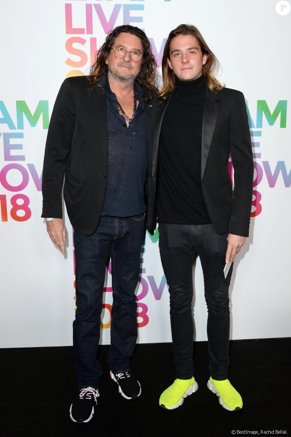 """Jacques-Antoine Granjon et son fils - Photocall du """"Etam Live Show 2018"""" aux Beaux-Arts à Paris, le 25 septembre 2018. © Rachid Bellak/Bestimage"""
