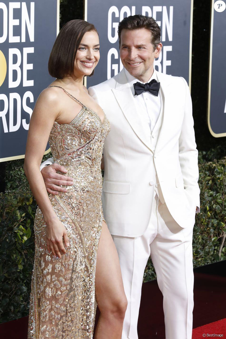 Irina Shayk (robe Atelier Versace) et son compagnon Bradley Cooper - Photocall de la 76ème cérémonie annuelle des Golden Globe Awards au Beverly Hilton Hotel à Los Angeles, le 6 janvier 2019.