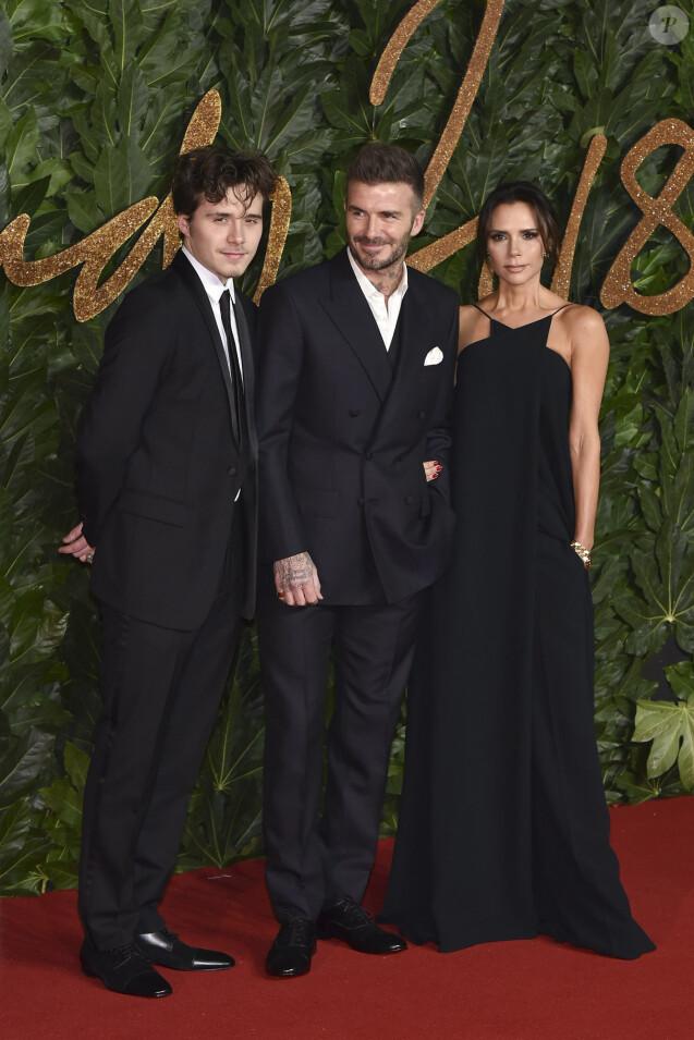 Brooklyn Beckham avec ses parents David Beckham et Victoria Beckham à la soirée British Fashion Awards 2018 au Royal Albert Hall à Londres, le 10 décembre 2018.