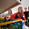 Le prince Harry, duc de Sussex, et Meghan Markle, duchesse de Sussex, enceinte (robe Oscar de la Renta) visitent le centre One25 une organisation caritative spécialisée dans l'aide aux femmes prostituées. Bristol le 1er février, 2019
